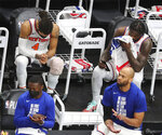 New York Knicks guard Derrick Rose, left, and forward Julius Randle, right, sit on the bench in the final minutes of a loss to the Atlanta Hawks in Game 4 of an NBA basketball first-round playoff series Sunday, May 30, 2021, in Atlanta. (Curtis Compton/Atlanta Journal-Constitution via AP)