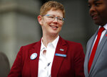 Kerrie Dallman, president of the Colorado Education Association, jokes with speakers during a rally outside the State Capitol Monday, April 16, 2018, in Denver. Teachers from around the state were on hand to demand better salaries as lawmakers under the dome were set to debate a pension reform measure to cut retirement benefits as well as take-home pay. (AP Photo/David Zalubowski)