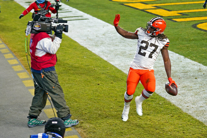 Cleveland Browns running back Kareem Hunt (27) celebrates after scoring on an 8-yard run during the first half of an NFL wild-card playoff football game against the Pittsburgh Steelers, Sunday, Jan. 10, 2021, in Pittsburgh. (AP Photo/Keith Srakocic)