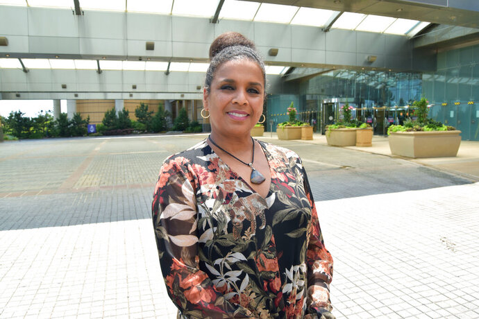 Melonie Johnson, the new president of the Borgata casino poses outside the casino Monday, June 29, 2020, in Atlantic City N.J.  Johnson is making history as the first Black woman to hold the title of president of an Atlantic City casino, and she's one of only a small handful of women with such a job nationwide.  (AP Photo/Wayne Parry)