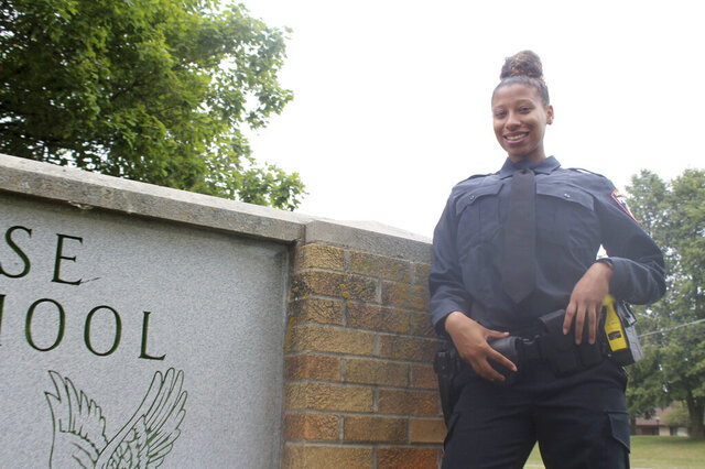 Kiara Riser, 21, is pictured on Saturday outside her alma mater Case High School in Racine, Wis. She is in the police academy at Gateway Technical College and has already been hired by the Caledonia Police Department, where she is set to become the first-ever Black female officer hired by the department. (Adam Rogan/The Journal Times via AP)