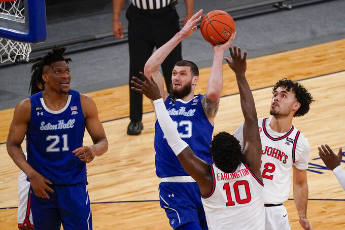 Seton Hall forward Sandro Mamukelashvili (23) shoots over St. John's forward Marcellus Earlington (10) during the first half of an NCAA college basketball game in the quarterfinals of the Big East conference tournament, Thursday, March 11, 2021, in New York. (AP Photo/Mary Altaffer)