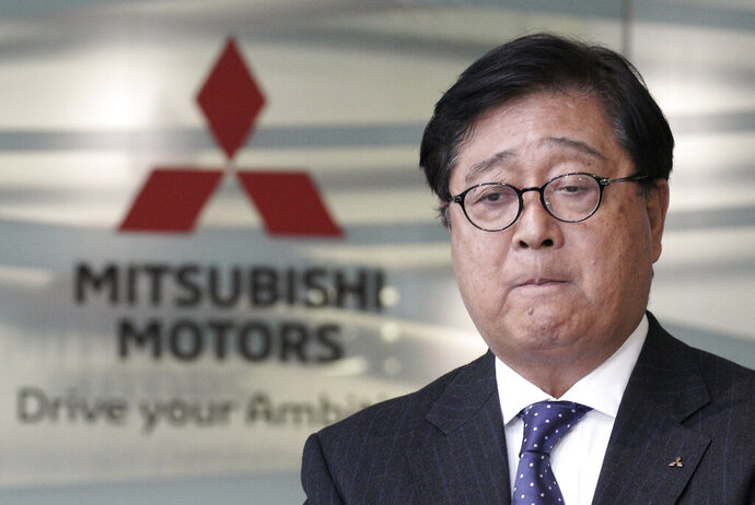 Mitsubishi Motors CEO Osamu Masuko bites his lips during a press conference at its headquarters in Tokyo Friday, Jan. 18, 2019. Masuko said the Japanese automaker's board met and discussed new allegations of wrongdoing by its former chairman, Carlos Ghosn. (AP Photo/Eugene Hoshiko)
