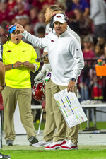 Arkansas head coach Chad Morris asks about a penalty against Alabama during the second half of an NCAA college football game, Saturday, Oct. 26, 2019, in Tuscaloosa, Ala. (AP Photo/Vasha Hunt)