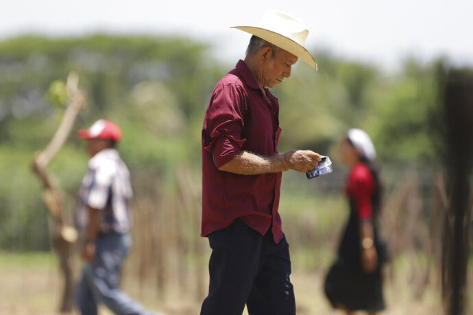 Salvadoran farmer Jose Jacobo Orellana, who five years ago saw his son leave illegally for the United States, walks during the launch of the