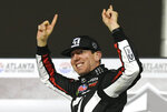 "FILE - In this Feb. 23, 2019, file photo ,Kyle Busch celebrates after winning the NASCAR Truck Series auto race at Atlanta Motor Speedway in Hampton, Ga. Busch says, ""Bring it on."" Chase Elliott and Kyle Larson are the latest topflight drivers to accept the challenge of Kevin Harvick, who has offered half of a $100,000 bounty to any Cup Series driver who can beat the versatile Busch in a Truck Series race this year. (AP Photo/John Amis, File)"