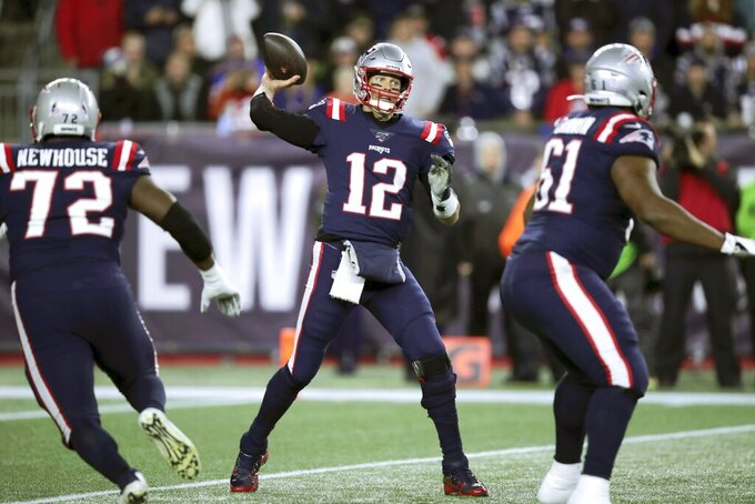 New England Patriots quarterback Tom Brady passes against the New York Giants in the first half of an NFL football game, Thursday, Oct. 10, 2019, in Foxborough, Mass. (AP Photo/Charles Krupa)
