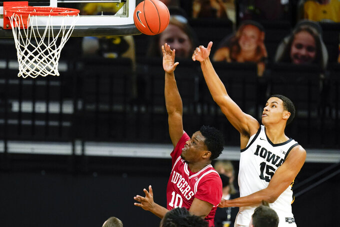 Rutgers guard Montez Mathis (10) drives to the basket past Iowa forward Keegan Murray (15) during the first half of an NCAA college basketball game, Wednesday, Feb. 10, 2021, in Iowa City, Iowa. (AP Photo/Charlie Neibergall)