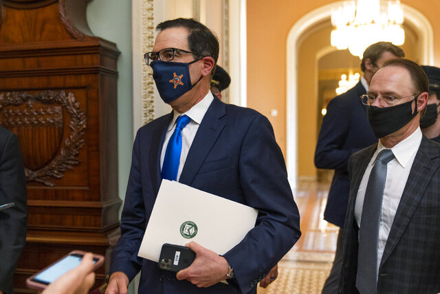Treasury Secretary Steven Mnuchin, makes a brief comment as he leaves the Capitol, Wednesday, Sept. 30, 2020, in Washington. Mnuchin earlier met with House Speaker Nancy Pelosi of Calif. (AP Photo/Manuel Balce Ceneta)
