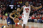 Michigan's David DeJulius (0) drives around Nebraska's Yvan Ouedraogo (24) during the first half of an NCAA college basketball game in Lincoln, Neb., Tuesday, Jan. 28, 2020. (AP Photo/Nati Harnik)