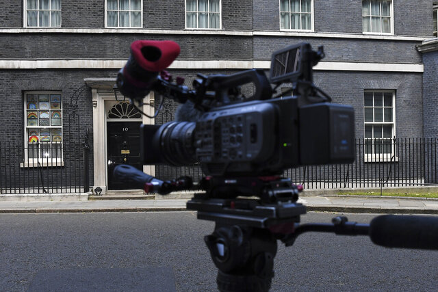 A media camera seen outside 10 Downing Street, in London, Monday, May 25, 2020.  Several lawmakers from Britain's governing Conservative Party have joined opposition calls for sanctions against Dominic Cummings, advisor to Prime Minister Boris Johnson, for allegedly flouting coronavirus lockdown rules. (AP Photo/Alberto Pezzali)