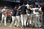 San Francisco Giants players celebrate after Mike Yastrzemski (obscured) hit a solo home run against the New York Mets during the 12th inning of a baseball game in San Francisco, Sunday, July 21, 2019. (AP Photo/Jeff Chiu)