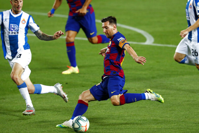 Barcelona's Lionel Messi fights for the ball between Espanyol's Victor Sanchez, left, during the Spanish La Liga soccer match between FC Barcelona and RCD Espanyol at the Camp Nou stadium in Barcelona, Spain, Wednesday, July 8, 2020. (AP Photo/Joan Monfort)