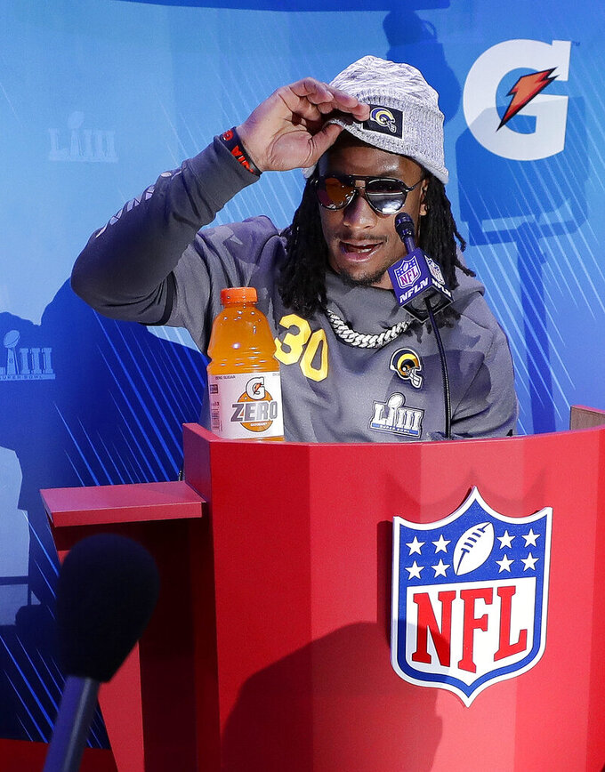 Los Angeles Rams' Todd Gurley adjusts his hat during Opening Night for the NFL Super Bowl 53 football game Monday, Jan. 28, 2019, in Atlanta. (AP Photo/David J. Phillip)