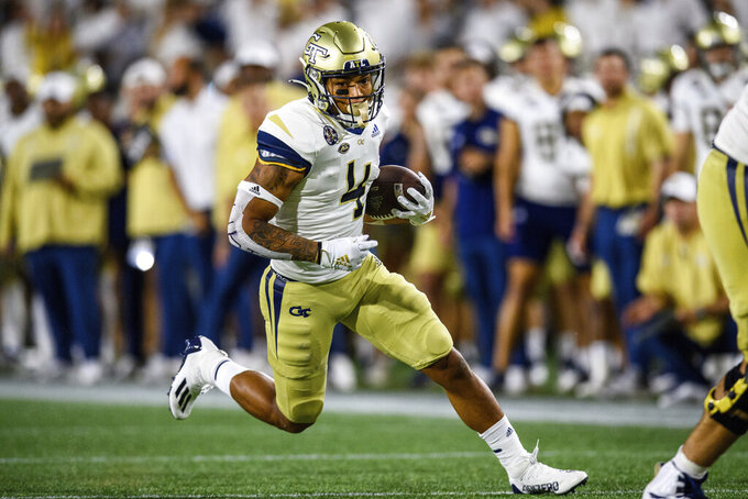 Georgia Tech running back Dontae Smith (4) runs for a touchdown during the second half of the team's NCAA football game against the Northern Illinois on Saturday, Sept. 4, 2021, in Atlanta. (AP Photo/Danny Karnik)