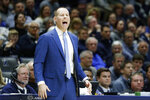 Xavier coach Travis Steele shouts to players during the first half of the team's NCAA college basketball game against Marquette, Wednesday, Jan. 29, 2020, in Cincinnati. (AP Photo/John Minchillo)