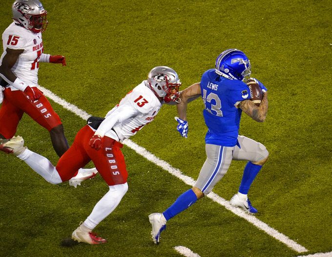 Air Force wide receiver Brandon Lewis, right, is tackled by New Mexico safety Nico Bolden, center, as safety Letayveon Beaton pursues during the second half of an NCAA college football game Friday, Nov. 20, 2020, at Air Force Academy, Colo. Air Force won 28-0. (AP Photo/David Zalubowski)