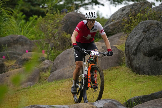 Linda Indergand of Switzerland competes during the women's cross-country mountain bike competition at the 2020 Summer Olympics, Tuesday, July 27, 2021, in Izu, Japan. (AP Photo/Christophe Ena)