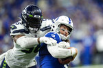 Seattle Seahawks linebacker Jordyn Brooks (56) sacks Indianapolis Colts quarterback Carson Wentz (2) during the second half of an NFL football game in Indianapolis, Sunday, Sept. 12, 2021. (AP Photo/AJ Mast)