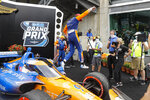 Race driver Scott Dixon, of New Zealand, jumps off his car after winning the IndyCar auto race at Indianapolis Motor Speedway in Indianapolis, Saturday, July 4, 2020. (AP Photo/Darron Cummings)