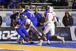 Boise State wide receiver Octavius Evans, left, falls into the end zone for a touchdown against New Mexico during the first half of an NCAA college football game Saturday, Nov. 16, 2019, in Boise, Idaho. (AP Photo/Steve Conner)