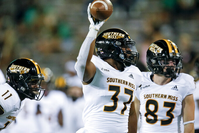 Southern Mississippi linebacker Devin Thomas (37) celebrates after recovering a North Texas fumble during the second half of an NCAA college football game on Saturday, Oct. 3, 2020, in Denton, Texas. (AP Photo/Brandon Wade)