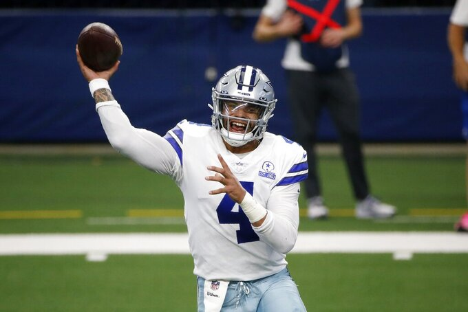 Dallas Cowboys quarterback Dak Prescott throws a pass in the first half of an NFL football game against the New York Giants in Arlington, Texas, Sunday, Oct. 11, 2020. (AP Photo/Michael Ainsworth)