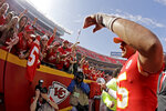 Kansas City Chiefs quarterback Patrick Mahomes, right, greets fans as he walks off the field after an NFL football game against the Baltimore Ravens, Sunday, Sept. 22, 2019, in Kansas City, Mo. (AP Photo/Charlie Riedel)