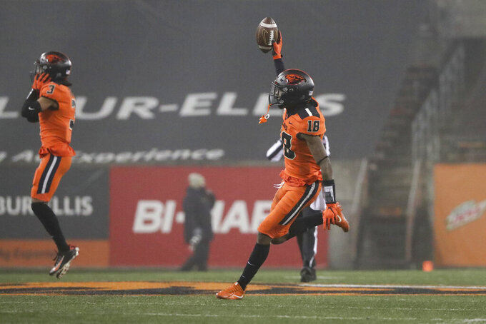 Oregon State defensive back Alex Austin holds up the ball after recovering an Oregon fumble to end the NCAA college football game in Corvallis, Ore., Friday, Nov. 27, 2020. Oregon State won 41-38. (AP Photo/Amanda Loman)