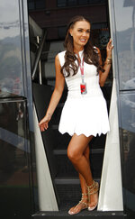 FILE - In this file photo dated Sunday, May 27, 2012, Tamara Ecclestone attends the Formula One Grand Prix, at the Monaco racetrack, in Monaco.  British police said Saturday Feb. 1, 2020, they have charged two people in connection with the December theft of millions of pounds' (dollars') worth of jewelry from the home of heiress Tamara Ecclestone. (AP Photo/Luca Bruno, FILE)