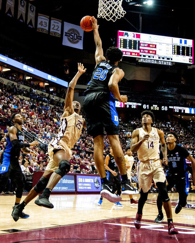 Duke center Marques Bolden blocks the shot of Florida State forward Mfiondu Kabengele in the second half of an NCAA college basketball game in Tallahassee, Fla., Saturday, Jan. 12, 2019. Duke defeated Florida State 80-78. (AP Photo/Mark Wallheiser)