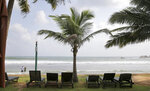FILE - In this May 10, 2019, file photo, lounge chairs lie on a deserted beach in Hikkaduwa, Sri Lanka. Sri Lanka's government says it will decrease ground handling charges for airlines and slash aviation fuel and embarkation taxes to help the country's vital tourism industry recover after the Easter attacks that killed more than 250 people. (AP Photo/Eranga Jayawardena, File)