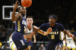 Oral Roberts' R.J. Fuqua, left, and Deondre Burns, right, fight for the ball with Iowa guard Joe Wieskamp, center, during the first half of an NCAA college basketball game, Friday, Nov. 15, 2019, in Iowa City, Iowa. (AP Photo/Charlie Neibergall)