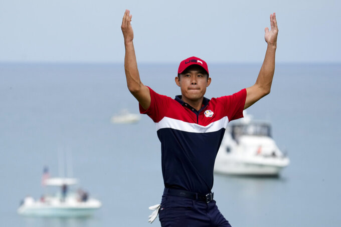 Team USA's Collin Morikawa reacts after winning the 17th hole during a Ryder Cup singles match at the Whistling Straits Golf Course Sunday, Sept. 26, 2021, in Sheboygan, Wis. (AP Photo/Ashley Landis)