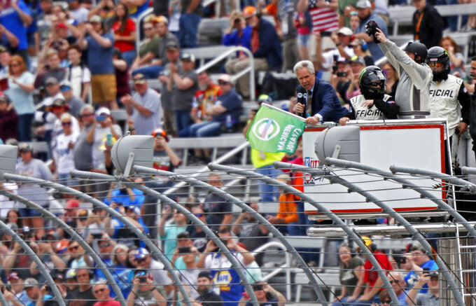 Hall of Fame driver and FOX announcer Darrell Waltrip waves the green flag to start during a NASCAR Cup Series auto race, Sunday, April 7, 2019, in Bristol, Tenn. (AP Photo/Wade Payne)