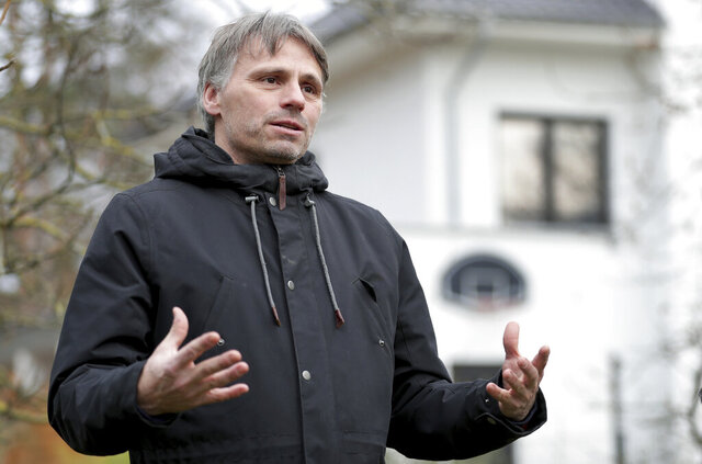 Fabian Leendertz, a biologist who specialized in emerging diseases at the Robert Koch Institute, speaks during an interview with the Associated Press in Falkensee, near Berlin, Germany, Tuesday, Dec. 15, 2020. (AP Photo/Michael Sohn)