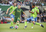 Portland Timbers' Sebastian Blanco works between Seattle Sounders, including Jordy Delem (21), during the first half of an MLS soccer match Friday, Aug. 23, 2019, in Portland, Ore. (Serena Morones/The Canadian Press via AP)