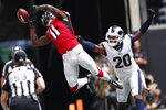 Atlanta Falcons wide receiver Julio Jones (11) misses the catch against Los Angeles Rams cornerback Jalen Ramsey (20) during the first half of an NFL football game, Sunday, Oct. 20, 2019, in Atlanta. (AP Photo/John Bazemore)