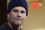 FILE - In this Jan. 4, 2020, file photo, New England Patriots quarterback Tom Brady listens to a question at his post-game news conference after the Patriots lost to the Tennessee Titans in an NFL wild-card playoff football game in Foxborough, Mass. Brady said on social media, Friday, March 20, 2020, he has signed with with the Tampa Bay Buccaneers. (AP Photo/Elise Amendola, File)