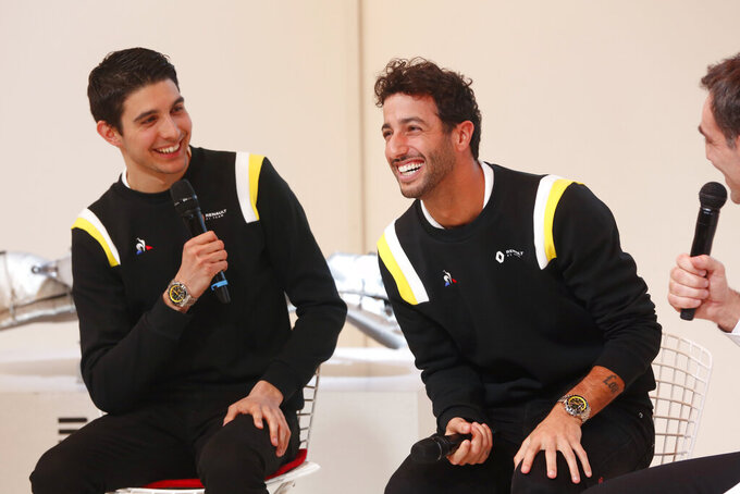 Renault drivers Daniel Ricciardo of Australia, right, and Esteban Ocon of France, left, attend a press conference, in Paris, Wednesday, Feb. 12, 2020. (AP Photo/Thibault Camus)