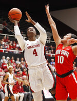 Stanford's Nadia Fingall (4) shoots as Ohio State's Braxtin Miller (10) defends during the first half of an NCAA college basketball game Sunday, Dec. 15, 2019, in Stanford, Calif. (AP Photo/George Nikitin)