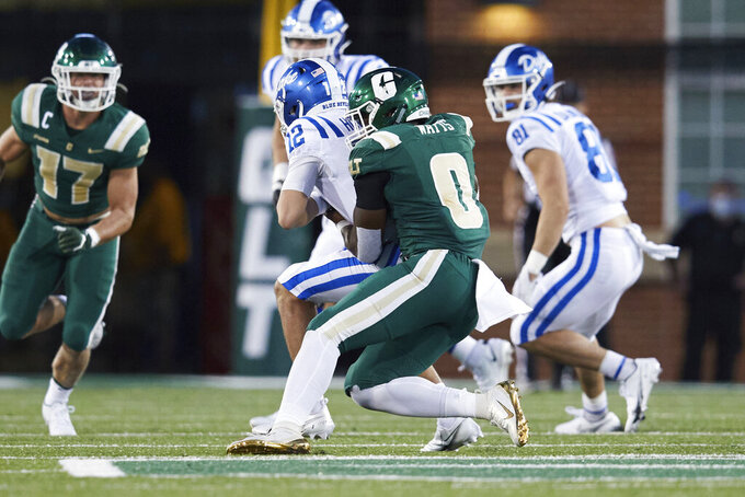 Duke quarterback Gunnar Holmberg (12) is sacked by Charlotte defensive end Markees Watts (0) during the first half of an NCAA football game Friday, Sept. 3, 2021, in Charlotte, N.C. (AP Photo/Brian Westerholt)