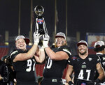 Ohio defensive lineman Kent Berger (97) and offensive lineman Austen Pleasants (60) hold the trophy with linebacker Evan Croutch (47) after the 27-0 win over San Diego State at the Frisco Bowl NCAA college football game, Wednesday, Dec. 19, 2018, in Frisco, Texas. (AP Photo/Richard W. Rodriguez)