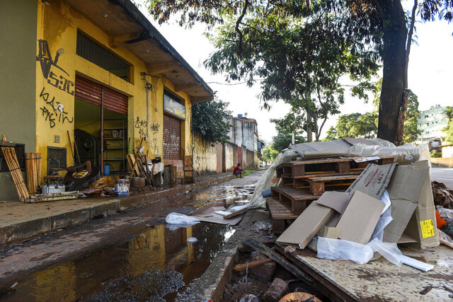 Furniture en other belongings are left on a street after heavy flooding caused by rains in Belo Horizonte, Brazil, Monday, Jan. 27, 2020. Over 30,000 people have been displaced by heavy rains in southeast Brazil that also killed more than 50 people. (AP Photo/Gustavo Andrade)