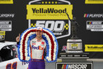 Denny Hamlin poses with the trophy after winning the NASCAR Cup Series auto race at Talladega Superspeedway on Sunday, Oct. 4, 2020, in Talladega, Ala. (AP Photo/John Bazemore)