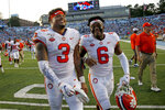 FILE - In this Sept. 28, 2019, file photo, Clemson's Xavier Thomas (3) and Mike Jones Jr. (6) celebrate after a failed North Carolina two-point conversion in the closing moments of an NCAA college football game in Chapel Hill, N.C. Clemson nearly saw a 19-game win streak end when North Carolina pushed the Tigers to the brink.  (AP Photo/Chris Seward, File)