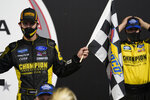Grant Enfinger, left, celebrates in Victory Lane after winning a NASCAR Truck Series auto race Thursday, Sept. 10, 2020, in Richmond, Va. (AP Photo/Steve Helber)