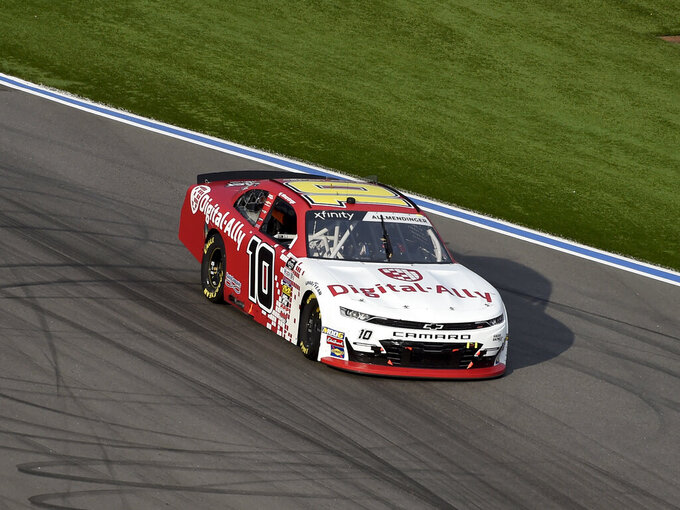 AJ Allmendinger (10) drives through Turn 16 during a NASCAR Xfinity Series auto race at Charlotte Motor Speedway, Saturday, Sept. 28, 2019 in Concord, N.C. (AP Photo/Mike McCarn)