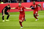 Toronto FC midfielder Jonathan Osorio (21) celebrates his second goal of the night, during extra time against D.C. United in an MLS soccer Eastern Conference first-round playoff match in Toronto on Saturday, Oct. 19, 2019. (Frank Gunn/The Canadian Press via AP)