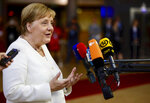 German Chancellor Angela Merkel speaks with the media as she arrives for an EU summit in Brussels, Sunday, June 30, 2019. European Union leaders have started another marathon session of talks desperately seeking a breakthrough in a diplomatic fight over who should be picked for a half dozen of jobs at the top of EU institutions. (AP Photo/Olivier Matthys)